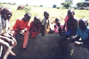 (Photograph of boys in Soroti around a well)